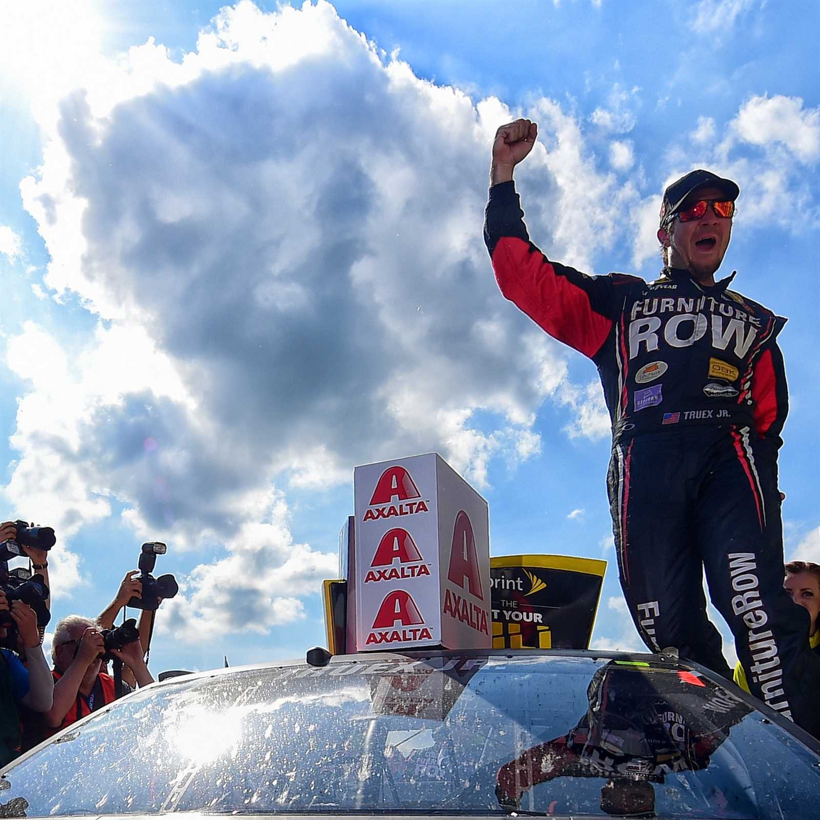 Truex Jr. takes Cup points lead after Larson penalty